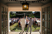 Daniel Egan, left, and Jeremy Morgan raise their hands in celebration as they are welcomed by guests at their wedding reception in Amagansett, New York on Independence Day weekend, 2014. Support for same-sex marriage in the US has changed more rapidly than almost any social issue in the past decade.