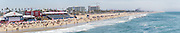 panoramic view of holiday makers on the Huntington Beach, California