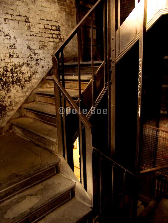 old stairway with open door in the background