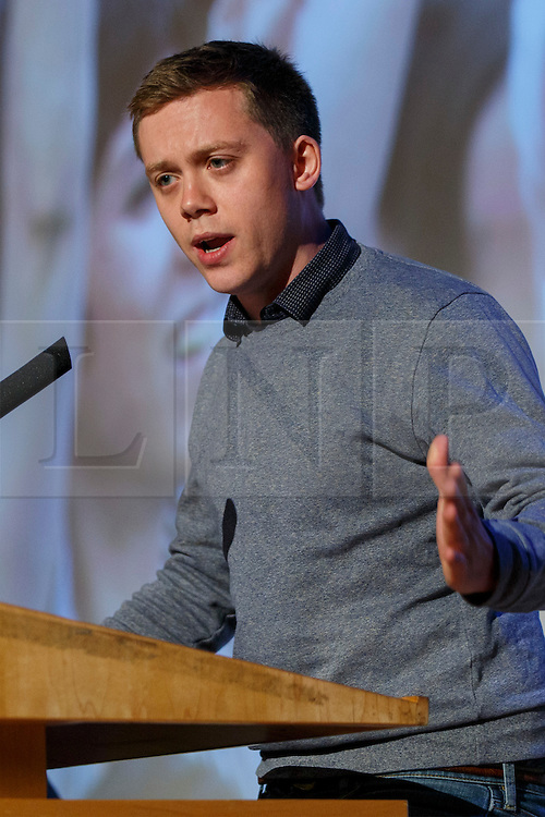 """© Licensed to London News Pictures. 28/05/2016. London, UK. OWEN JONES speaking at """"Another Europe is Possible"""" rally at UCL Institute of Education in London, campaigning for a remain vote at the upcoming EU referendum.  Speakers at the event include Shadow Chancellor John McDonnell, former Greek Finance Minister Yanis Varoufakis and Green Party MP Caroline Lucas. Photo credit: Tolga Akmen/LNP"""