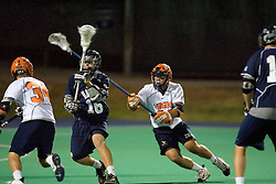 Georgetown Hoyas A Andrew Baird (16) is checked by Virginia Cavaliers D Tim Shaw (28)...The Virginia Cavaliers men's lacrosse team faced the Georgetown Hoyas in a Fall Ball Scrimmage held at the University Hall Turf Field in Charlottesville, VA on October 12, 2007.