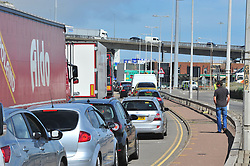 © Licensed to London News Pictures. 24/07/2016<br /> TRAFFIC DRIVING INTO DOVER DOCKS.<br /> The Dover traffic hell continues today (24.07.2016) in Kent.<br /> Long queues at the Port of Dover this afternoon<br />  because of very long delays at French border control. <br /> (Byline:Grant Falvey/LNP)