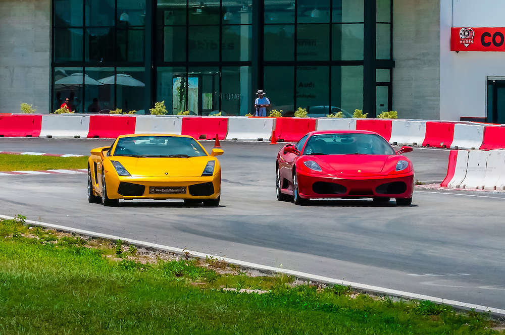 Lamborghini Gallardo (yellow) and Ferrari F430 (red) on the track at Exotic Rides Mexico. Exotic Rides Mexico gives guests the opportunity to drive the most exotic and exclusive cars in the world on a 1.1 mile private race track in Cancun, Quintana Roo, Mexico.