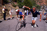 Race participant gets watered on High School Hill, Bisbee, Arizona.©1988 Edward McCain. All rights reserved. McCain Photography, McCain Creative, Inc.