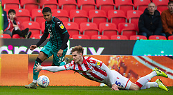 STOKE-ON-TRENT, ENGLAND - Saturday, January 25, 2020: Swansea City's Rhian Brewster gets away from Stoke City's Liam Lindsay during the Football League Championship match between Stoke City FC and Swansea City FC at the Britannia Stadium. (Pic by David Rawcliffe/Propaganda)