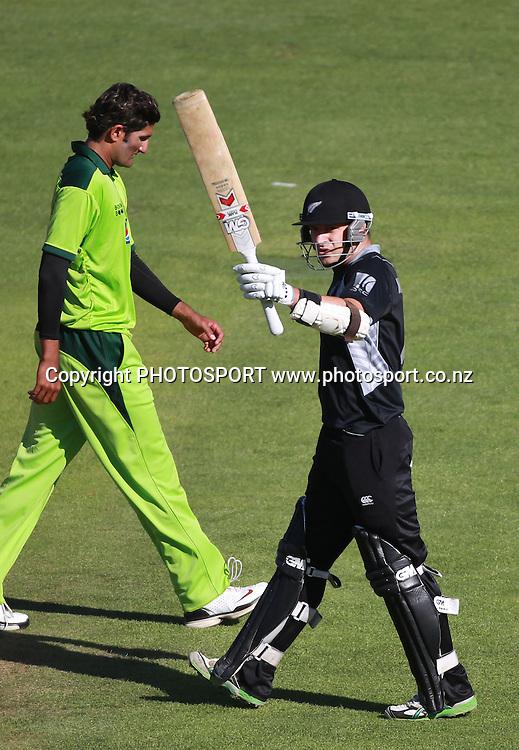 Nathan McCullum celebrates his 50 as Sohail Tanvir looks on during the 4th ODI, Black Caps v Pakistan, One Day International Cricket. McLean Park, Napier, New Zealand. Tuesday 1 February 2011. Photo: Andrew Cornaga/photosport.co.nz