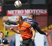 Dundee United's Sean Dillon heads clear from Dundee's Luka Tankulic  - Dundee United v Dundee at Tannadice Park in the SPFL Premiership<br /> <br />  - © David Young - www.davidyoungphoto.co.uk - email: davidyoungphoto@gmail.com