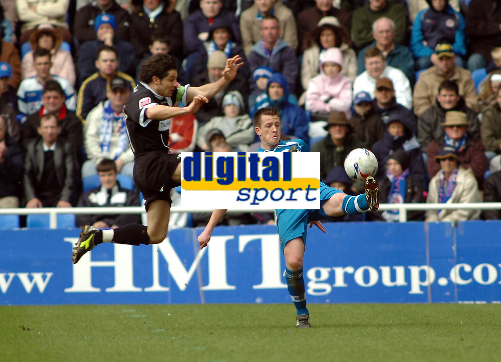 Photo: Kevin Poolman.<br />Reading v Derby County. Coca Cola Championship. 01/04/2006. Nicky Shorey of Reading gets challenged by Derby's Paul Peschisolido