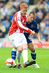 STOKE, ENGLAND - Sunday, September 14, 2008: Everton's Phil Jagielka and Stoke City's Dave Kitson during the Premiership match at the Britannia Stadium. (Photo by David Rawcliffe/Propaganda)