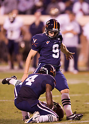 Virginia kicker Chris Gould (9) kicks an extra point against Pitt.  The Virginia Cavaliers defeated the Pittsburgh Panthers 44-14 at Scott Stadium in Charlottesville, VA on September 29, 2007.