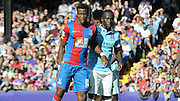 Bacaray Sagna keeps a close watch on Wilfred Zaha during the Barclays Premier League match between Crystal Palace and Manchester City at Selhurst Park, London, England on 12 September 2015. Photo by Michael Hulf.