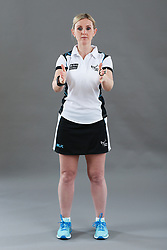Umpire Alison Davies signalling obstruction of player with ball