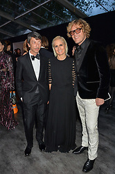 Left to right, PIERPAOLO PICCIOLI, MARIA GRAZIA CHIURI and PETER DUNDAS at British Vogue's Centenary Gala Dinner in Kensington Gardens, London on 23rd May 2016.