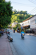 Street scene in Luang Prabang, Laos, with Mount Phousi in the background.
