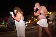Revelers dressed in togas during Fantasy Fest halloween parade in Key West, Florida.
