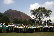 "African volunteers hold signs bearing the names of participating celebrities and VIP's  at a public tree planting ceremony sponsored by the Abuja Green Society in association with the ThisDay ""Africa Rising"" Festival July 11, 2008 at the Abuja Central Park in Abuja, Nigeria. Celebrity guests of the festival, Super model Naomi Campbell and fashion designer Ozwald Boateng planted trees at the event, drawing attention to African environmental issues and providing an opportunity to project a positive image of Africa as part of the festival's larger focus.  ."