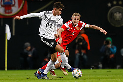 November 15, 2018 - Leipzig, Germany - Kai Havertz (L) of Germany and Yury Gazinsky of Russia vie for the ball during the international friendly match between Germany and Russia on November 15, 2018 at Red Bull Arena in Leipzig, Germany. (Credit Image: © Mike Kireev/NurPhoto via ZUMA Press)
