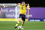 Oxford United defender Elliott Moore (5) sprints forward with the ball during the EFL Sky Bet League 1 match between Oxford United and Shrewsbury Town at the Kassam Stadium, Oxford, England on 7 December 2019.