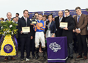 Juan-Carlos Capelli, right, VP and Head of International Marketing, Longines, presents Conquest Classic timepieces to trainer Aidan O'Brien, second right, owners Michael Tabor and Vivienne Day, center, and jockey Ryan Moore after their horse Found won the Longines Breeders' Cup Turf race at Keeneland Racecourse on Saturday, Oct. 31, 2015 in Lexington, KY.  Longines, the Swiss watch manufacturer known for its elegant timepieces, is the Official Watch and Timekeeper of the Breeders' Cup World Championships and the Triple Crown. (Photo by Diane Bondareff/Invsion for Longines/AP Images)