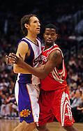 Jan. 6 2010; Phoenix, AZ, USA; Houston Rockets guard Aaron Brooks (0) defends Phoenix Suns guard Steve Nash (13) at the US Airways Center. Phoenix Suns defeated the Houston Rockets 118-110.  Mandatory Credit: Jennifer Stewart-US PRESSWIRE