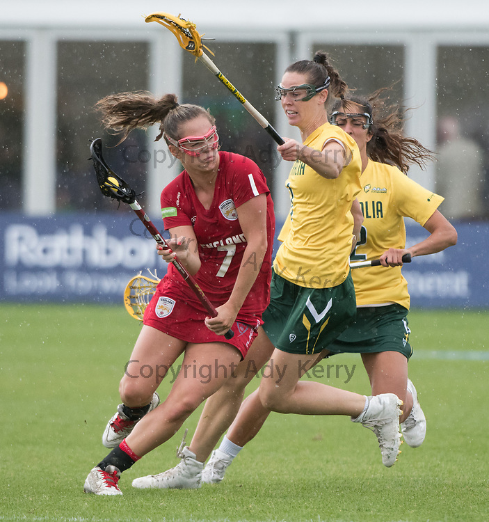 England's Emma Adam evades Australia's Abbie Burgess at the 2017 FIL Rathbones Women's Lacrosse World Cup at Surrey Sports Park, Guilford, Surrey, UK, 15th July 2017
