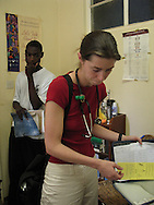Zimbabwe, Howard Hospital, 2006. Dr Amy Acker after consulting with Dr Paul Thistle about a particular patient's case.
