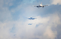 © Licensed to London News Pictures. 27/02/2020. London, UK. Four passenger aircraft are seen together on final approach to London's Heathrow Airport. Earlier, in a ruling at the High Court, judges halted the planned construction of a third runway at the London airport saying the decision was unlawful because it did not take UK climate commitments into account. Photo credit: Peter Macdiarmid/LNP