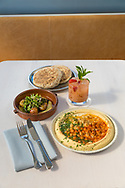 The Flat Bread, Classic Hummus and New Potato with Zucchini, all vegan dishes, at Tusk, a Middle Eastern Restaurant in Portland, OR