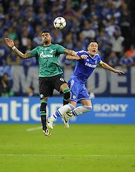 Chelsea's John Terry battles for the high ball with FC Schalke 04 Kevin-Prince Boateng - Photo mandatory by-line: Joe Meredith/JMP - Tel: Mobile: 07966 386802 22/10/2013 - SPORT - FOOTBALL - Veltins-Arena - Gelsenkirchen - FC Schalke 04 v Chelsea - CHAMPIONS LEAGUE - GROUP E