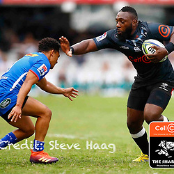 Tendai Beast Mtawarira of the Cell C Sharks looks to hand off Herschel Jantjies of the DHL Stormers during the Super Rugby match between Cell C Sharks and DHL Stormers at Jonsson Kings Park on March 02, 2019 in Durban, South Africa. (Photo by Steve Haag)