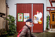 """Offer for traditional """"Apfelwein"""" what is a kind of cyder in the old part of Oberursel during a rainy day."""