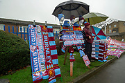 A Burnley scarf and pin badge stall outside Turf moor prior to the Premier League match between Burnley and West Ham United at Turf Moor, Burnley, England on 30 December 2018.