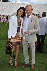 GEOFFREY KENT and OTAVIA JARDIM at the 27th annual Cartier International Polo Day featuring the 100th Coronation Cup between England and Brazil held at Guards Polo Club, Windsor Great Park, Berkshire on 24th July 2011.