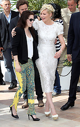 Kristen Stewart and Kirsten Dunst at the Cannes Film Festival for their new film On The Road, Wednesday, 23rd  May 2012. Photo by: Stephen Lock / i-Images