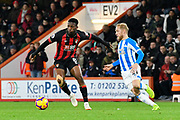 Jefferson Lerma (8) of AFC Bournemouth being closed down by Alex Pritchard (21) of Huddersfield Town during the Premier League match between Bournemouth and Huddersfield Town at the Vitality Stadium, Bournemouth, England on 4 December 2018.