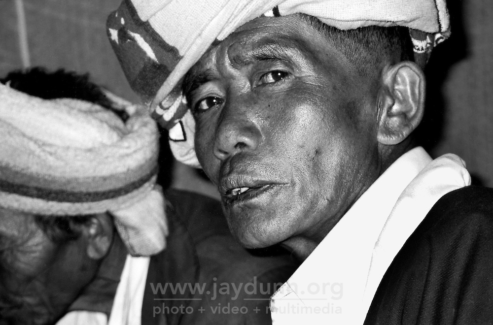 BURMA (MYANMAR),Shan State, Peinnebin, 2006. The village chief ensures everything is in place the night before the wedding. Palaung tradition allows separation if the marriage does not work out.