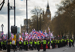 London, April 1st 2017. Against the backdrop of Big Ben, protesters from nationalist and anti-Islamic group Britain First leave the site of their demonstration in London following the Westminster terror attack of March 22nd.