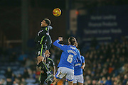 York City forward Vadaine Oliver wins the ball ahead of Portsmouth defender Christian Burgess  during the Sky Bet League 2 match between Portsmouth and York City at Fratton Park, Portsmouth, England on 24 November 2015. Photo by Simon Davies.