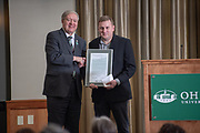 President Nellis presents John Bowditch with the Outstanding Administrator Award. Photo by Ben Siegel