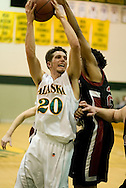 1/6/2006: Freshman guard Trenton Millar (20) of the UAA Seawolves goes for two as Anchorage goes on to beat the visiting Central Washington Wildcats, 80-60 at the Wells Fargo Sports Complex on the campus of UAA.<br />