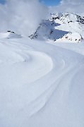 Wind sculpted snow on ridge in the Alps on the Austria/Italy border.