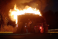 Middletown, NY - Firefighters light a bonfire with flares at a  homecoming pep rally at Middletown High School on the evening of Oct. 17, 2008.