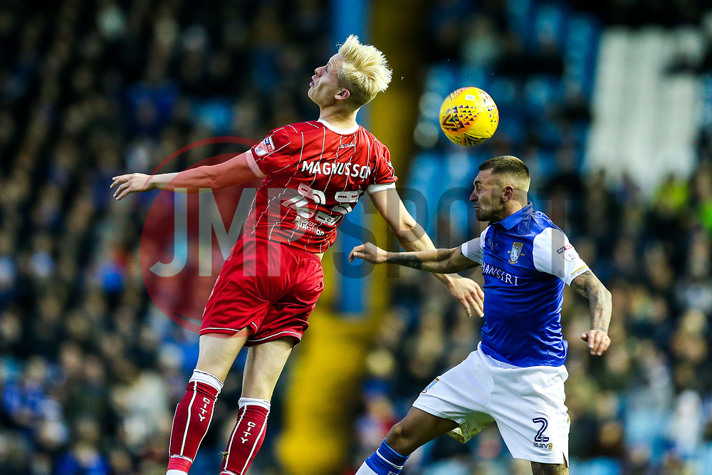 Hordur Magnusson of Bristol City and Jack Hunt of Sheffield Wednesday compete in the air - Rogan/JMP - 18/11/2017 - Hillsborough Stadium - Sheffield, England - Sheffield Wednesday v Bristol City - Sky Bet Championship.