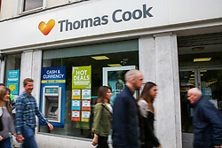 "© Licensed to London News Pictures. 18/05/2019. London, UK. People walk past a Thomas Cook branch in central London. <br /> Holiday group, Thomas Cook risks collapse with thousands of holiday bookings in jeopardy as its shares dropped by more than 40 per cent on Friday after it was announced that the company recorded a £1.5 billion loss for the first half of the year and City analysts branded them as ""worthless"". Photo credit: Dinendra Haria/LNP"