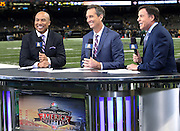 NBC Sports football analysts (L-R) former Pittsburgh Steelers wide receiver Hines Ward and former Cincinnati Bengals wide receiver Cris Collinsworth work with NBC Sports sportscaster Bob Costas as they talk about the upcoming game between the New Orleans Saints and the Green Bay Packers at the NFL week 8 regular season football game on Sunday, Oct. 26, 2014 in New Orleans. The Saints won the game 44-23. ©Paul Anthony Spinelli