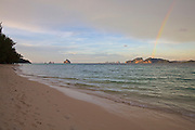 Thailand, Ko Kradan. The beach at sunset, with a rainbow.