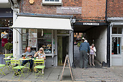 A cafe and passageway in the market town of Ludlow, on 11th September 2018, in Ludlow, Shropshire, England UK.