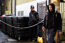 © licensed to London News Pictures. London, UK 06/02/2014. Police officers investigating an alleyway off Charing Cross Road close to Leicester Square in central London after a body has been found on Thursday, 6 February 2014. The body is believed to be missing Irish teenager Patrick Halpin who was last seen in the area on Tuesday, 4 February 2014. Photo credit: Tolga Akmen/LNP