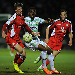 Yeovil Town's Gozie Ugwu is tackled by Walsall's Paul Downing  - Photo mandatory by-line: Harry Trump/JMP - Mobile: 07966 386802 - 03/03/15 - SPORT - Football - Sky Bet League One - Yeovil v Walsall - Huish Park, Yeovil, England.