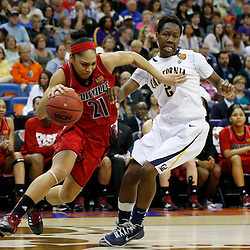 April 7, 2013; New Orleans, LA, USA; Louisville Cardinals guard Bria Smith (21) dribbles against California Golden Bears guard Afure Jemerigbe (2) during the second half in the semifinals during the 2013 NCAA womens Final Four at the New Orleans Arena. Mandatory Credit: Derick E. Hingle-USA TODAY Sports